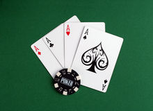Four aces and bet. On a table Royalty Free Stock Images