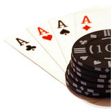 Four aces and a big stack of chips stock photo