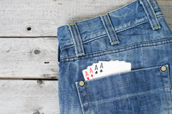 Four aces in blue jeans back pocket Stock Photography