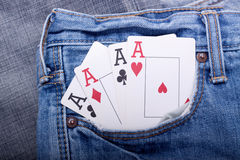 Four aces in blue jeans pocket Royalty Free Stock Image