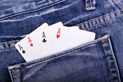 Four aces in blue jeans pocket Royalty Free Stock Photography