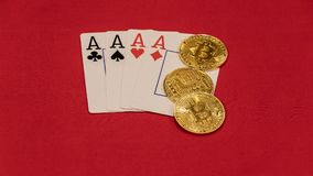 Four aces poker hand with bitcoins stock image