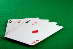 Four aces on card table Stock Photos