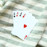 Four aces cards on stripe background. Four aces cards on stripe cloth background Royalty Free Stock Photography