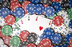 Four aces on casino chips Stock Photography