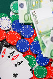Four aces on casino table. Four aces ,chips and money on casino table Royalty Free Stock Image