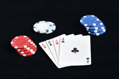 Four aces with chips on a black background Stock Photography