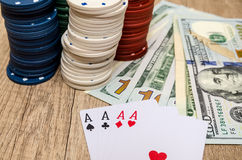 Four aces  with chips and dollar Stock Photos
