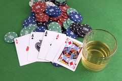 Four Aces on chips and and glass of whisky Stock Photography