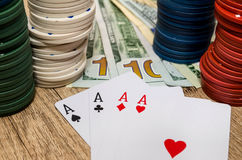 Four aces  with chips and us dollar Stock Image