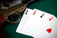 Four aces and colt Royalty Free Stock Image