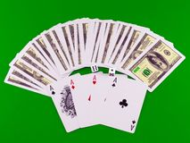 Four aces and dice on green broadcloth . Royalty Free Stock Photography