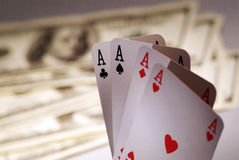 Four Aces and  dollars. Royalty Free Stock Photos