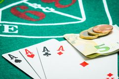 Four aces and euros Royalty Free Stock Photo