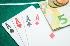 Four aces and euros Stock Photo