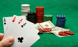 Four aces with gambling chips. Over green felt royalty free stock photo