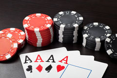 Four aces and gambling chips Royalty Free Stock Photos