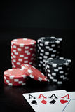 Four aces and gambling chips Stock Image
