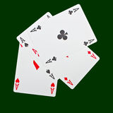 Four aces  on green. A winning poker hand of four aces playing cards suits on green Royalty Free Stock Photography