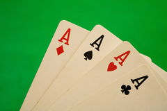 Four aces  on green background casino games fortune luck Stock Photo