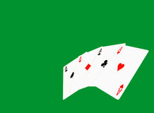 Four aces on green casino background. Royalty Free Stock Image