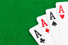 Four aces on green felt Royalty Free Stock Image