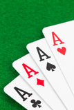Four aces on green felt Royalty Free Stock Photography