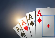 Four aces on grey Stock Photos