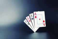 Four aces on grey Stock Photography