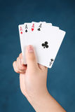 Four aces on hand Stock Images