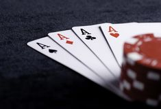 Four aces high on black table with chips Royalty Free Stock Photos