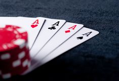 Four aces high on black table with chips Royalty Free Stock Photo