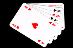 Four aces and joker. On black background Stock Photos