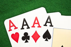 Four aces macro shot on green background Royalty Free Stock Photos