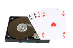Four Aces and magnetic computer hard disk Royalty Free Stock Photos