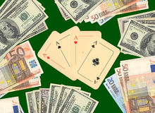 Four aces and money on a green table Royalty Free Stock Images