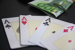 Four aces next to bundles of euro banknotes Stock Images