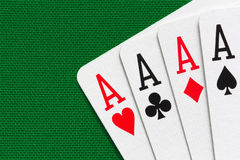 Four aces over green textile background. Close-up view stock photos