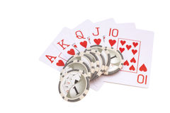 Four aces playing cards and casino chips. Isolated on white Royalty Free Stock Photo