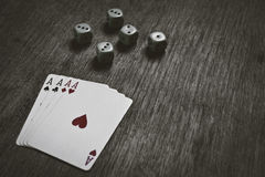 Four aces playing cards and dice with copyspace Royalty Free Stock Images
