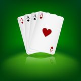Four aces playing cards on green background. Stock Photos