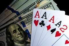 Four aces Playing Cards and Stack of 100 American Dollars Bills. royalty free stock image