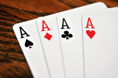 Four Aces - Playing Cards on Wooden Stock Photo