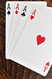 Four Aces - Playing Cards on Wooden Royalty Free Stock Photos