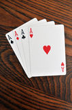 Four Aces - Playing Cards on Wooden Stock Photography