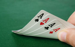Four aces poker hand. For aces poker hand on green table royalty free stock photography