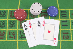 Four aces with poker rooms royalty free stock image