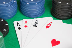 Four aces and poker stacked chips Stock Photos