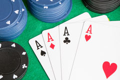 Four aces and poker stacked chips Stock Photography