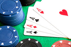 Four aces and poker stacked chips Stock Images